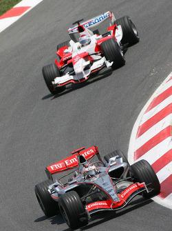 Kimi Raikkonen leads Jarno Trulli