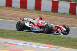 Ralf Schumacher loses his front wing after an accident with his teammate Jarno Trulli