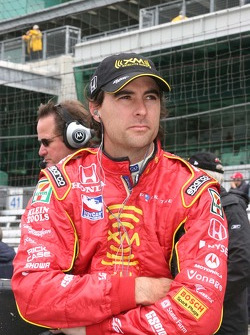 Bryan Herta wait for the rain to stop falling