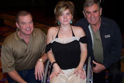 Cody Unser poses with her famous father, two-time Indy 500 winner Al Unser Jr. and grandfather, four-time Indy 500 winner Al Unser Sr., at the Salvation Army Women's Auxiliary's first annual Spring Luncheon Tuesday in Indianapolis