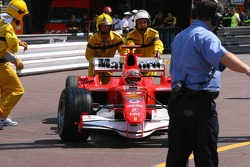 Michael Schumacher pushed to Parc Fermé