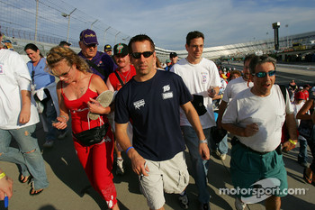 Greg Biffle walks with fans during a charity walk benefiting the NASCAR Foundation at Dover International Speedway