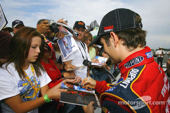 Jeff Gordon signs autographs for his fans