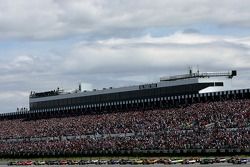 The field heads for the start line to take the green flag