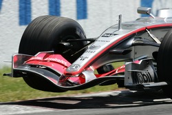 Juan Pablo Montoya lifts a wheel