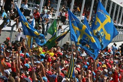 Fans of Fernando Alonso celebrate