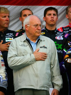 U.S. Vice President Dick Cheney stands on stage for the playing of the National Anthem with the drivers