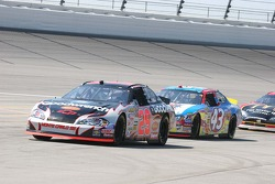 Kevin Harvick leads Bobby Labonte onto pitlane