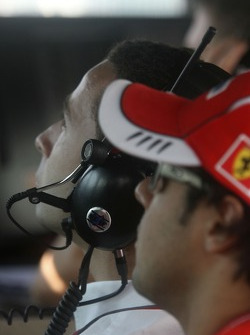 Felipe Massa watches the GP2 race with Nicolas Todt