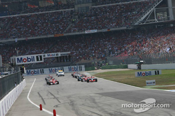 Start: Kimi Raikkonen takes the lead ahead of Michael Schumacher and Felipe Massa