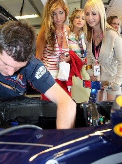 Formula Unas girls in the garage of Red Bull Racing