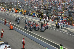 Indianapolis police motorcycle patrolmen perform during pre-race