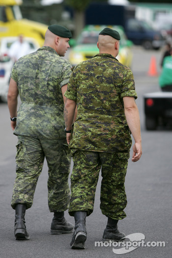 Members of the Canadian Army watch the paddock activity