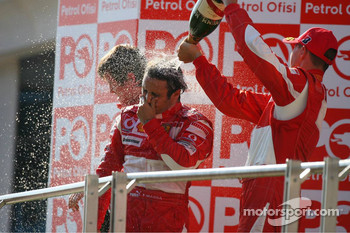 Podium: race winner Felipe Massa with Michael Schumacher