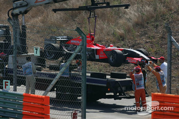 Tiago Monteiro's Midland Toyota M16 is loaded onto a lorry