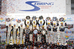 Class winners podium: P class winners Joao Barbosa, Christian Fittipaldi, Sébastien Bourdais, PC class winners Mike Guasch, Andrew Palmer, Tom Kimber-Smith, GTLM class winners Jan Magnussen, Antonio Garcia, Ryan Briscoe, GTD class winners Ian James, Mario