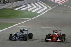 Nico Rosberg, Mercedes AMG F1 W06 and Sebastian Vettel, Ferrari SF15-T battle for position
