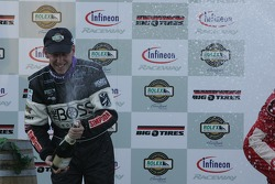 Podium: Champagne for Andy Wallace