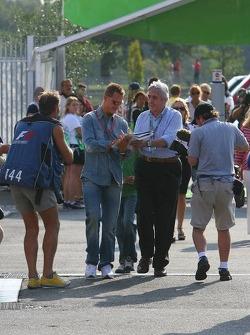 Michael Schumacher signs autographs for fans