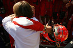 Race winner Michael Schumacher celebrates with Luca di Montezemolo