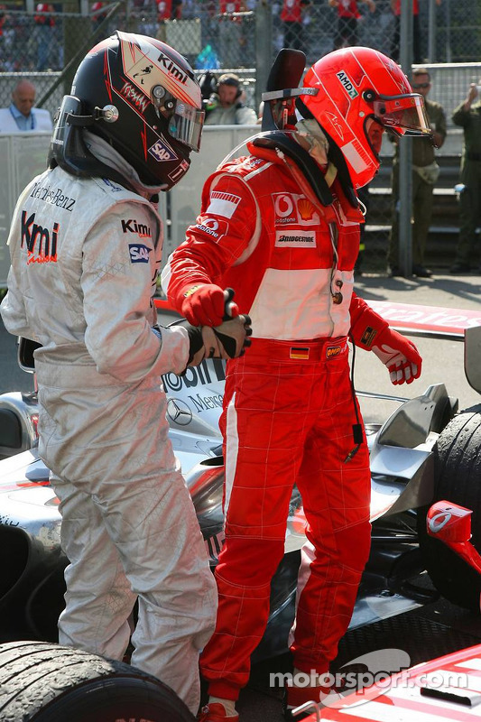 Race winner Michael Schumacher with Kimi Raikkonen