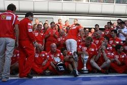 Michael Schumacher celebrates his 90th win and the 190th for Ferrari with Ferrari team members