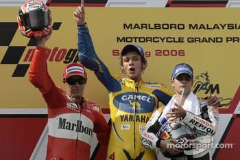 Podium: race winner Valentino Rossi with Loris Capirossi and Dani Pedrosa