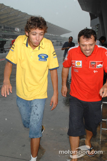 Valentino Rossi and Loris Capirossi in the rain
