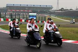 Takuma Sato and Sakon Yamamoto ride the circuit