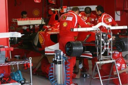 Mechanics work on the car of Michael Schumacher