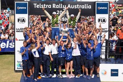 Podium: winners Mikko Hirvonen and Jarmo Lehtinen celebrate with BP Ford team members