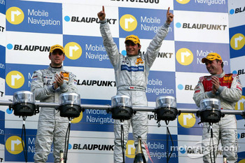 Podium: race winner Bruno Spengler with Jamie Green and Tom Kristensen