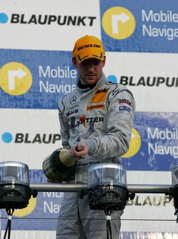 Podium: champagne for Jamie Green