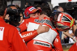 Race winner Troy Bayliss celebrates with Loris Capirossi