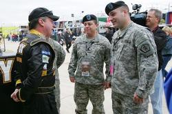 Joe Nemechek talks with members of the U.S. ARMY