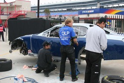 Tony Raines crew members fix the damage sustained in happy hour