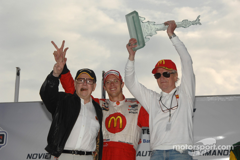 Sebastien Bourdais with Carl Haas and Paul Newman celebrate another victory