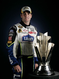Championship victory lane: 2006 NASCAR Nextel Cup champion Jimmie Johnson poses with the Nextel Cup