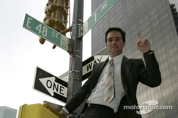 Jimmie Johnson, the driver of the No. 48 Lowe's Chevrolet, celebrates his first place finish while in New York City