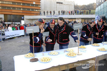 Dr Mario Theissen with BMW Motorsports drivers tasting cheese