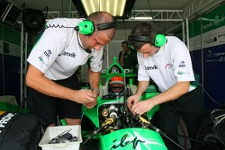 A1Team crew members work on Richard Lyons car