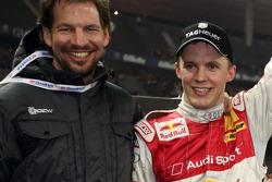 Race of Champions winner Mattias Ekström celebrates with Fredrik Johnsson