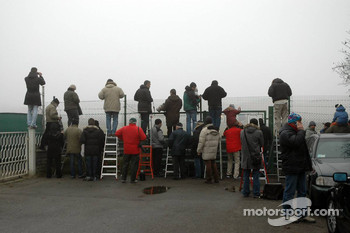 Photographers wait for Felipe Massa in the Ferrari F2007