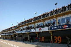 A lot of fans on the roof of the pitbox building