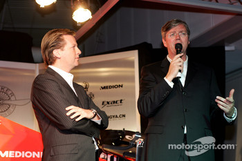 Chief Executive Victor Muller talks about the car with Director Michiel Mol