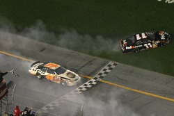 Dale Jarrett and Denny Hamlin spin while taking the checkered flag