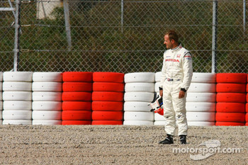 Rubens Barrichello spins into the gravel