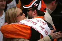 Victory lane: race winner Tony Stewart celebrates with girlfriend