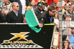 Hall of Fame Quarterback Troy Aikman waives the green flag to start the NASCAR Nextel Cup Series Auto Club 500