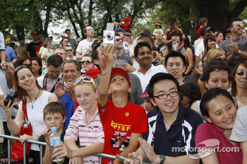Fans watch the Ferrari street parade